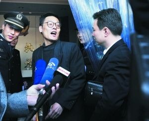 Ma Yaohai, a 53-year-old college professor, interviewed by the reporters before he went in court .