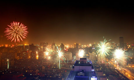 Fireworks explode in the air to celebrate the Chinese new year in 2011 in Beijing. Photograph: Lintao Zhang/Getty Images